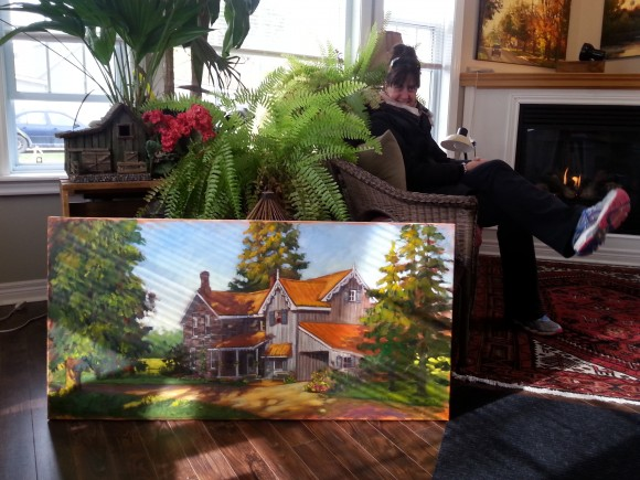 My sister Kate basking in the light next to a commissioned painting.